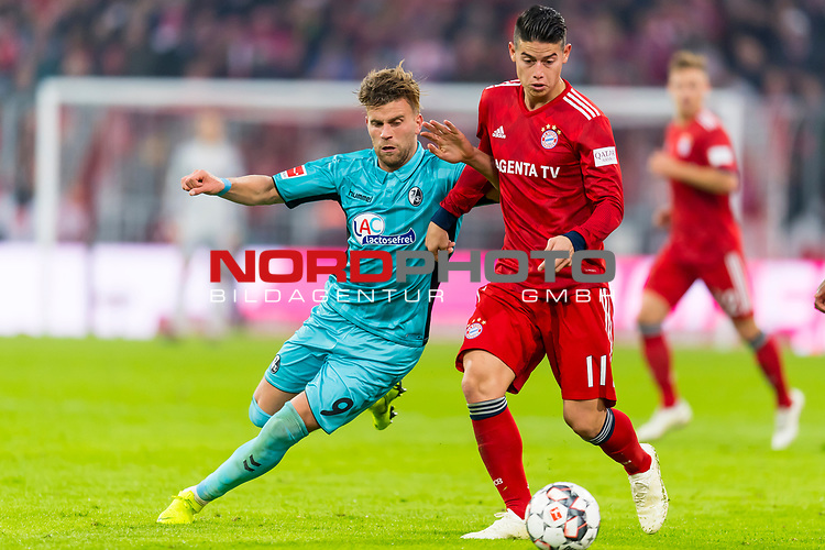03.11.2018, Allianz Arena, Muenchen, GER, 1.FBL,  FC Bayern Muenchen vs. SC Freiburg, DFL regulations prohibit any use of photographs as image sequences and/or quasi-video, im Bild Lucas Hoeler (Freiburg #9) im kampf mit James Rodriguez (FCB #11) <br /> <br />  Foto © nordphoto / Straubmeier