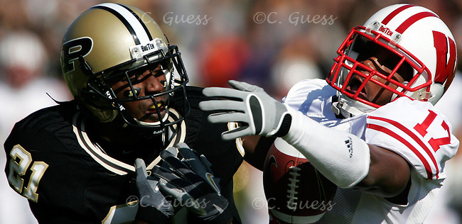 University of Wisconsin's Allen Langford wrestles with Purdue's Greg Orton over a possible interception in the Wisconsin vs. Purdue match up held in Ross-Ade Stadium on October 21, 2006. Wisconsin would go on to win the game in a crushing 24-3 victory.