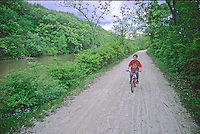 A boy rides his bike along the I&M Canal Hiking Trail, between Chanahon State Park and McKinley Woods Forest Preserve in Will County, Illinois
