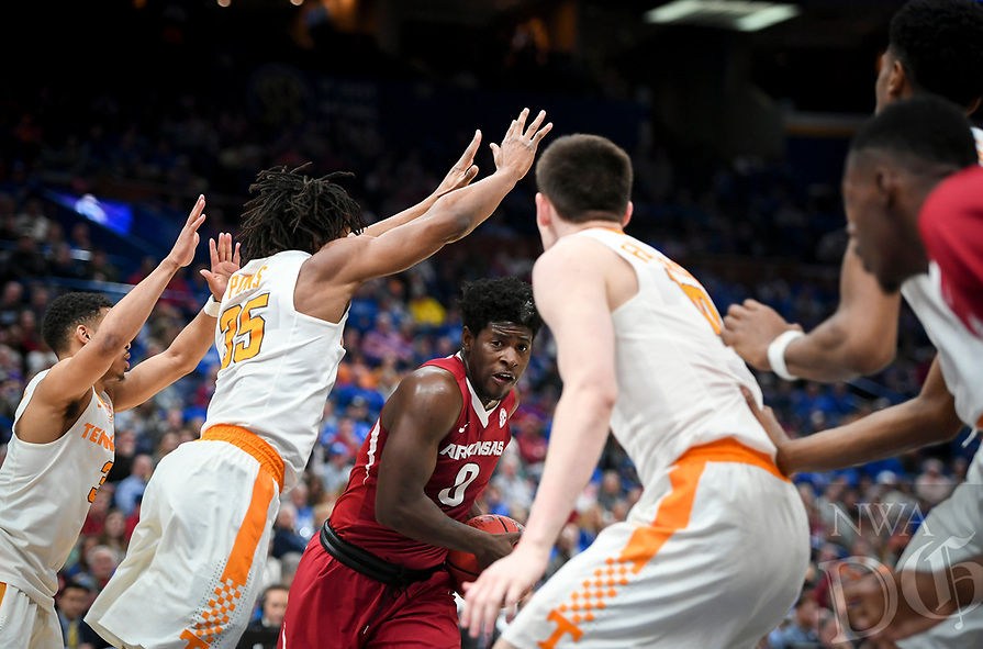 NWA Democrat-Gazette/CHARLIE KAIJO Arkansas Razorbacks guard Jaylen Barford (0) looks for an opening as Tennessee Volunteers players cover him during the Southeastern Conference Men's Basketball Tournament semifinals, Saturday, March 10, 2018 at Scottrade Center in St. Louis, Mo. The Tennessee Volunteers knocked off the Arkansas Razorbacks 84-66