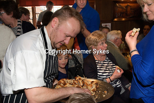 Horndon on the Hill Essex. The Bell Inn, Hot Cross buns are prepared by Chef and distributed amongst Good Friday drinkers.<br /> Head chef Stuart Fay.