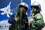 "Visitors wearing militar pilots' helmet pose for the cameras at the Niconico Douga fan event at Makuhari Messe International Exhibition Hall on April 25, 2015, Chiba, Japan. The event includes special attractions such as J-pop concerts, Sumo and Pro Wrestling matches, cosplay and manga and various robot performances and is broadcast live on via the video-sharing site. Niconico Douga (in English ""Smiley, Smiley Video"") is one of Japan's biggest video community sites where users can upload, view, share videos and write comments directly in real time, creating a sense of a shared watching. According to the organizers more than 200,000 viewers for two days will see the event by internet. The popular event is held in all 11 halls of the huge Makuhari Messe exhibition center from April 25 to 26. (Photo by Rodrigo Reyes Marin/AFLO)"