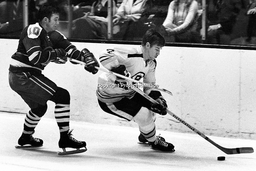 California Golden Seal Ted Hampton chasing Boston Bruin Bobby Orr. (1970 photo by Ron Riesterer)