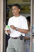 Honolulu, HI - December 26, 2008 -- United States President-elect Barack Obama walks out of Kokonuts Shave Ice and Snacks at Koko Head Marina with the local treat in hand Friday, December 26, 2008 in Honolulu, Hawaii. .Credit: Kent Nishimura - Pool via CNP