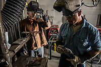Instructor Greg Russo helps student Samson Phillips with his welding technique during Russo's Welding Lab in UAA's Gordon Hartlieb Hall.