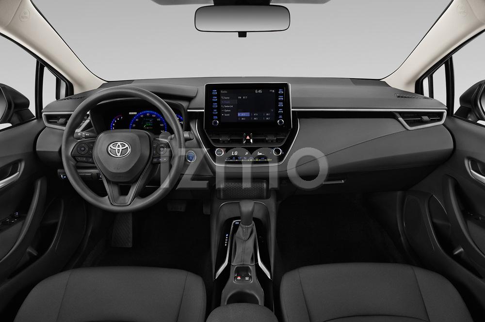 Stock photo of straight dashboard view of 2020 Toyota Corolla-Hybrid LE 4 Door Sedan Dashboard