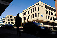 Man passing the headquarters of LGT, the largest bank in the country, owned by the ruling royal family. Liechtenstein has become a major tax haven, whose opaque banking laws are said to aid fraud, money laundering and tax evasion. There are an estimated 75,000 companies registered in the country, twice that of the population. .