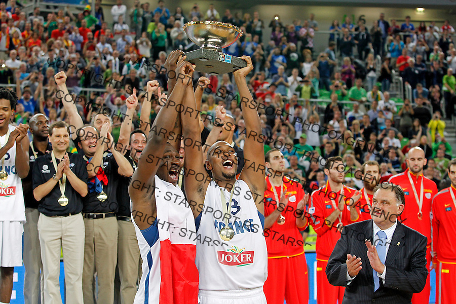 "France`s Florent Pietrus and Boris Diaw celebrate with the trophy after European basketball championship ""Eurobasket 2013""  final game between France and Lithuania in Stozice Arena in Ljubljana, Slovenia, on September 22. 2013. (credit: Pedja Milosavljevic  / thepedja@gmail.com / +381641260959)"