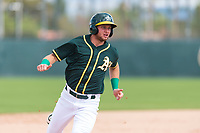 Oakland Athletics third baseman Nick Osborne (7) runs the bases during an exhibition game against Team Italy at Lew Wolff Training Complex on October 3, 2018 in Mesa, Arizona. (Zachary Lucy/Four Seam Images)