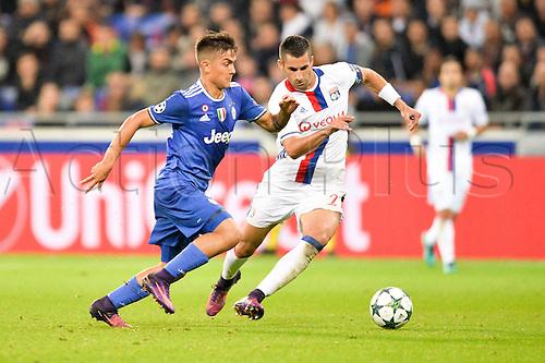 18.10.2016. Lyon, FRance. UEFA Champions League football. Lyon versus Juventus.  MAXIME GONALONS (ol) chases the loose ball with Paulo Dybala (juve)