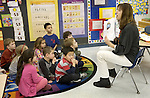 SOUTHBURY, CT. 14 January 2013-011413SV01- Kindergarten teacher Nikki Kulis goes over a reading lesson with students at Gainfield Elementary School in Southbury Monday. The Region 15 Board of Education will vote on both a full-day kindergarten and redistricting plan to take effect in the 2013-14 school year.<br />Steven Valenti Republican-American