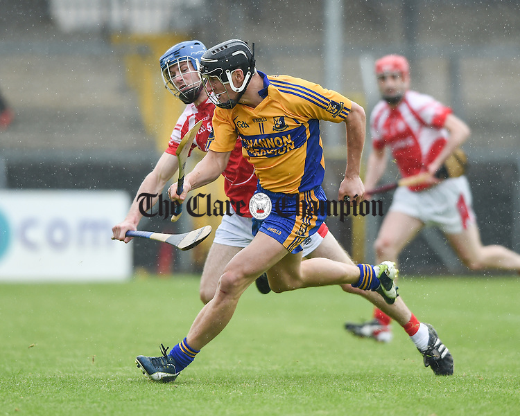 Shane Golden of Sixmilebridge in action against Ciaran Russell of Eire Og during their match in Ennis. Photograph by John Kelly.