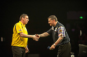 09.04.2015. Sheffield, England. Betway Premier League Darts. Matchday 10.  Gary Anderson [SCO] congratulates Dave Chisnall [ENG] after the winning double in their match.