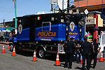 Mexicali policemen stand alongside large truck for use if needed during the Easter festivities.