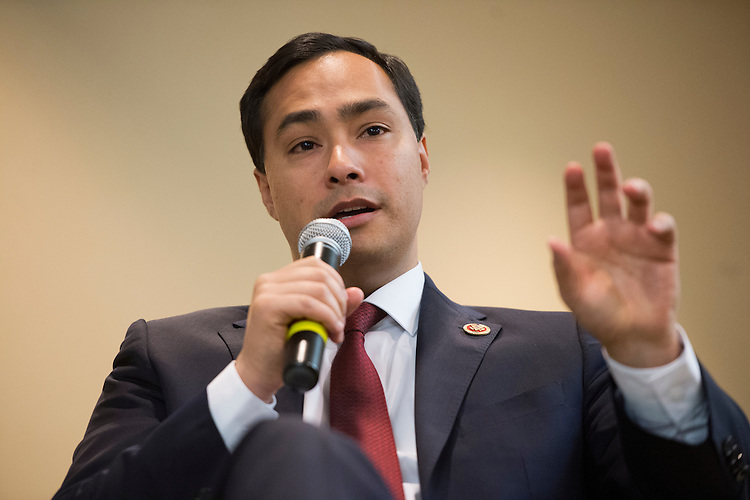 "UNITED STATES - MARCH 05:  Rep. Joaquin Castro, D-Texas, and his brother Julian Castro, mayor of San Antonio, not pictured, participate in a discussion at the ""SA to DC"" conference held at the Marriott at Metro Center. The event which, is organized by the Hispanic Chamber, the Greater San Antonio Chamber of Commerce and the Free Trade Alliance, brings business leaders and elected officials from San Antonio to advocate for the city. (Photo By Tom Williams/CQ Roll Call)"