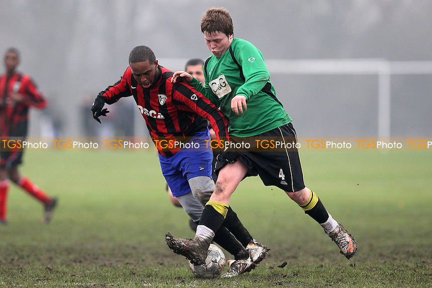Concordia (red/black) vs Homerton Rangers 'B' (green) - East London Sunday League Football at South Marsh, Hackney Marshes, London - 20/02/11 - MANDATORY CREDIT: Gavin Ellis/TGSPHOTO - Self billing applies where appropriate - Tel: 0845 094 6026