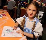Emma Hamilton,5, colors at the Disney table at the Little Galleria Halloween Spooktacular presented by MD Anderson Children's Cancer Hospital at The Galleria Sunday Oct. 30,2016.(Dave Rossman photo)