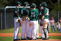 Dartmouth Big Green head coach Bob Whalen (2) talks with his team including catcher Adam Gauthier (18), third baseman Justin Fowler (25), shortstop Nate Ostmo (19), second baseman Dustin Shirley (far left), Chris Burkholder (center), and first baseman Michael Ketchmark (back) during a game against the Eastern Michigan Eagles on February 25, 2017 at North Charlotte Regional Park in Port Charlotte, Florida.  Dartmouth defeated Eastern Michigan 8-4.  (Mike Janes/Four Seam Images)