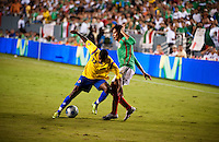 Midfielder Dorlan Pabón (cq, 22) of Colombia fights Midfielder Braulio Luna (cq) of Mexico in an exhibition game at the Cotton Bowl in Dallas, Texas, USA, Wednesday, Sept., 30, 2009. Colombia won the game 2-1, which was played as the second game of a double header after an FC Dallas soccer game in an attempt by Major League Soccer to draw a new crowd of hispanic people to the sport in the US...PHOTOS/ MATT NAGER