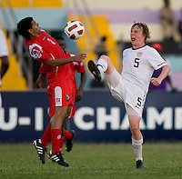 Matthew Dunn (5) of the United States tries to take the ball away from Eric Francisco (2) of Panama during the group stage of the CONCACAF Men's Under 17 Championship at Jarrett Park in Montego Bay, Jamaica. The USA defeated Panama, 1-0.