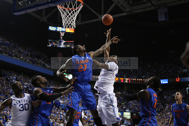 UK center Dakari Johnson takes a tough shot over Florida forward Chris Walker during the first half of the UK vs. Florida men's basketball game at Rupp Arena in Lexington, Ky., on Saturday, February, 15, 2014. Photo by Jonathan Krueger | Staff