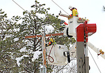 Crews from Ohio Edison replace a Cross Arm on a utility pole after a snowstorm in Jackson, New Jersey.
