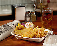 Fish & Chips on bar counter with newspaper.
