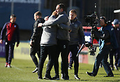 17th March 2019, Dens Park, Dundee, Scotland; Ladbrokes Premiership football, Dundee versus Celtic; Celtic Caretaker Manager Neil Lennon hugs Celtic Coach John Kennedy at the final whistle after the injury time winner