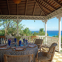 A sunny terrace has spectacular views over the Grenadine Islands and the azure blue water of the Caribbean