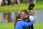 Miguel Angel Jiminez gets a kiss on the 18th green after winning his match in the Session 3 Foursomes and Fourball Matches during Day 3 of the The 2010 Ryder Cup at the Celtic Manor, Newport, Wales, 3rd October 2010..(Picture Eoin Clarke/www.golffile.ie)