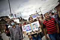 Protestors, holding pictures of JKLF (Jammu Kashmir Liberation Front) 'martyrs', shout anti-Indian slogans and clash with Indian police during a protest in downtown Srinagar, the day after Kashmir went to the polls in the Indian national elections.