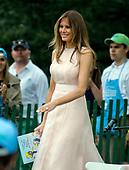 "First lady Melania Trump prepares to read ""Party Animals"" by Kathie Lee Gifford to a group of children as she and United States President Donald J. Trump host the annual Easter Egg Roll on the South Lawn of the White House in Washington, DC on Monday, April 17, 2017.<br /> Credit: Ron Sachs / CNP"