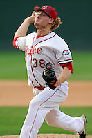 Pitcher Ryan Harris (38) of the Greenville Drive delivers a pitch in a game against the Savannah Sand Gnats on Sunday, July 5, 2015, at Fluor Field at the West End in Greenville, South Carolina. Savannah won, 8-6. (Tom Priddy/Four Seam Images)