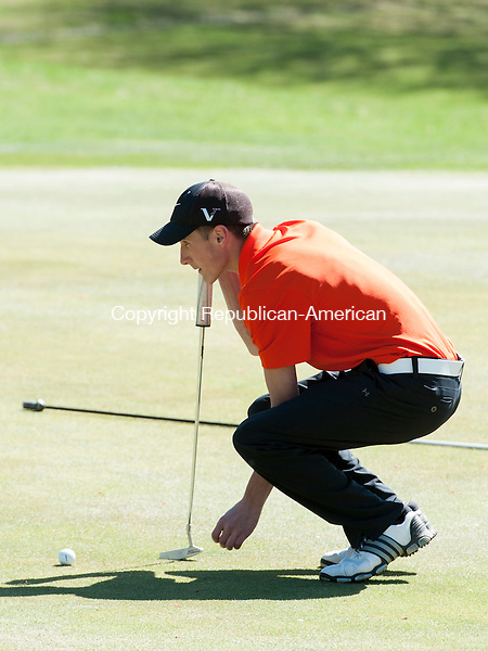 WATERTOWN, CT-28 April 2015-042815EC03-  Watertown's Tom Labbe lines up his putt Tuesday afternoon at Crestbrook Park GOlf Course in Watertown. Erin Covey Republican-American