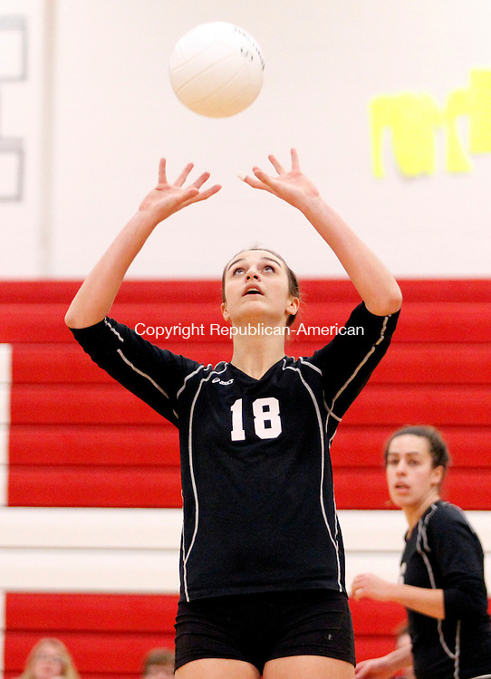 Southbury, CT- 08, November 2010-110810CM12 Pomperaug's Lauren Baranowski sets the ball Monday night against Woodstock Academy in Southbury.  Christopher Massa Republican-American