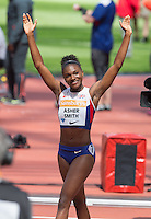 Dina Asher-Smith celebrates as she makes a new British record during the Sainsbury's Anniversary Games, Athletics event at the Olympic Park, London, England on 25 July 2015. Photo by Andy Rowland.