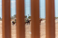 MEXICALI, MEXICO - April 5 Border Patrol agents are seen from the mexican side of the border fence on April 5, 2019 in Mexicali, Mexico.<br /> President Trump on Friday visited Calexico, a small city in a largely agricultural region between Arizona and the Pacific, to inspect an upgraded portion of fencing and to meet with law enforcement. That's more attention than usual for a border town that locals say is defined by its interconnection with Mexico, its infernal summers and its labor-based economy. <br /> (Photo by Luis Boza/VIEWpress)