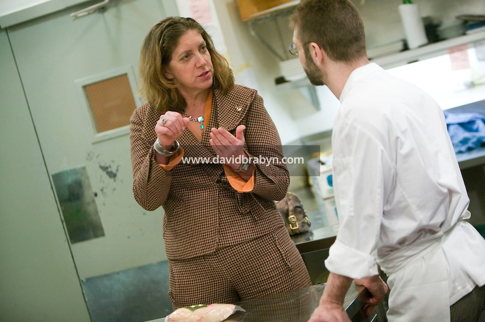 19 December 2006 - New York City, NY - Ariane Daguin (L), owner of food distribution company D'Artagnan, talks to her client chef David Waltuck in the kitchen of his restaurant Chanterelle in New York City, USA 19 December 2006.