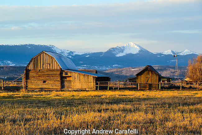 The old barns of Mormon Row near Kelly, Wyoming catch the sun's first rays.
