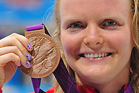 PICTURE BY ALEX BROADWAY /SWPIX.COM - 2012 London Paralympic Games - Day Five - Swimming, Aquatic Centre, Olympic Park, London, England - 03/09/12 - Susannah Rodgers of Great Britain poses with her medal after winning Bronze in the Women's 100m Freestyle S7 Final.