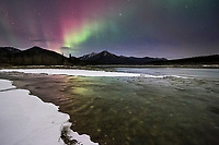 Colorful aurora over the Koyukuk River in Alaska's Brooks Range mountains.