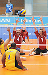 November 18 2011 - Guadalajara, Mexico:  Larry Matthews and Douglas Learoyd of Team Canada prepare to block a shot while taking on Columbia in the Bronze Medal Game in the Pan American Volleyball Complex at the 2011 Parapan American Games in Guadalajara, Mexico.  Photos: Matthew Murnaghan/Canadian Paralympic Committee