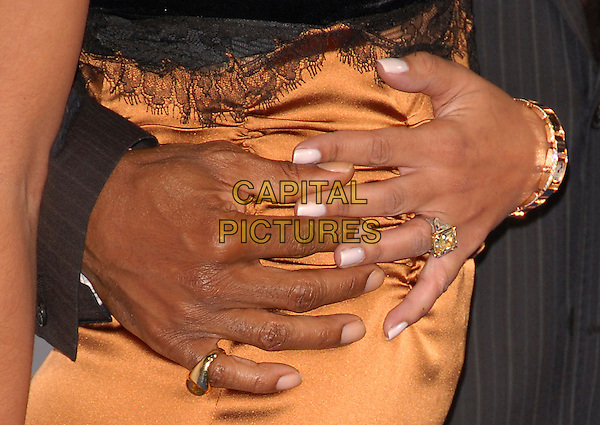 """TRACEY EDMONDS & EDDIE MURPHY.The Lionsgate L.A. Premiere of """"Good Luck Chuck"""" held at The Mann National Theatre in Westwood, California, USA..September 19th, 2007                  .half length bronze gold dress holding hands rings around waist stomach brown.CAP/DVS.©Debbie VanStory/Capital Pictures"""