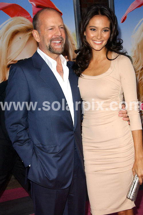 """**ALL ROUND PICTURES FROM SOLARPIX.COM**.**SYNDICATION RIGHTS FOR UK, SPAIN, PORTUGAL, AUSTRALIA, S.AFRICA & DUBAI (U.A.E) ONLY**.arrivals for the Los Angeles Premiere of """"The House Bunny"""" at Mann's Village Theatre, Westwood, CA, USA. 20th August 2008..This pic: Bruce Willis and Emma Heming..JOB REF: 7061 PHZ/Ortega    DATE: 20_08_2008.**MUST CREDIT SOLARPIX.COM OR DOUBLE FEE WILL BE CHARGED* *UNDER NO CIRCUMSTANCES IS THIS IMAGE TO BE REPRODUCED FOR ANY ONLINE EDITION WITHOUT PRIOR PERMISSION*"""