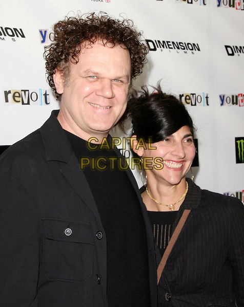 JOHN C.REILLY & ALISON DICKEY.The Weinstein Company Film premiere of ''Youth In Revolt'' held at The Mann Chinese 6 Theatre in Hollywood, California, USA..January 6th, 2010.headshot portrait black half length jacket married husband wife .CAP/RKE/DVS.©DVS/RockinExposures/Capital Pictures.