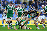 Shane Geraghty of London Irish is tackled to ground by Chris Cook of Bath Rugby. Aviva Premiership match, between London Irish and Bath Rugby on November 7, 2015 at the Madejski Stadium in Reading, England. Photo by: Patrick Khachfe / Onside Images