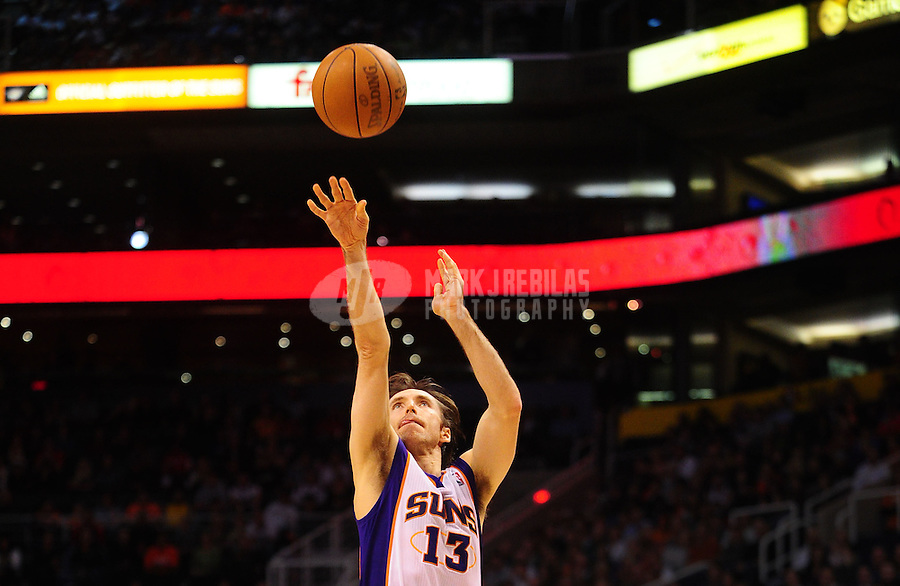 Jan. 14, 2011; Phoenix, AZ, USA; Phoenix Suns guard (13) Steve Nash against the Portland Trailblazers at the US Airways Center. The Suns defeated the Trailblazers 115-111. Mandatory Credit: Mark J. Rebilas-