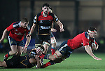Robin Copeland of Munster Rugby is brought to the ground by Loose-head prop Brok Harris of Newport Gwent Dragons.<br /> <br /> Guiness Pro 12<br /> Newport Gwent Dragons v Munster Rugby<br /> Rodney Parade<br /> 21.11.14<br /> &copy;Steve Pope-SPORTINGWALES