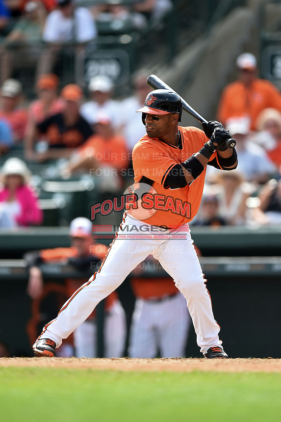 Baltimore Orioles shortstop Alexi Casilla (12) during a spring training game against the Pittsburgh Pirates on March 23, 2014 at Ed Smith Stadium in Sarasota, Florida.  Baltimore and Pittsburgh tied 7-7.  (Mike Janes/Four Seam Images)