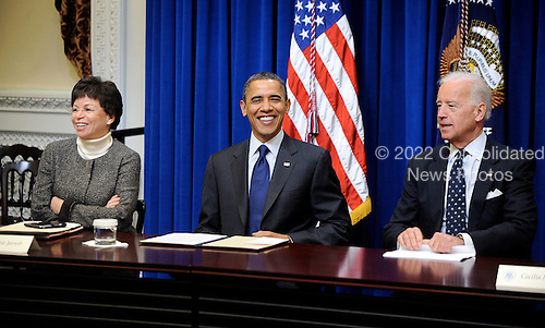 United States President Barack Obama flanked by Vice President Joe Biden, right, and Valerie Jarrett, left, meets with Democratic Governors in the Eisenhower Executive Office Building on Friday, February 25, 2011 in Washington D.C. President Obama and the Governors discussed the ways Washington and the states can work together to grow the economy and create jobs..Credit: Olivier Douleiry / Pool via CNP